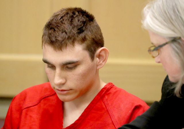 FILE - In this Feb. 19, 2018 file photo, Nikolas Cruz, accused of murdering 17 people in the Florida high school shooting, appears in court for a status hearing in Fort Lauderdale, Fla. Cruz reportedly had a history of shooting small animals. While some animal welfare advocates question the usefulness of animal abuser registries, laws creating them have been passed in a growing number of municipalities in recent years with proponents citing studies linking animal cruelty to crimes...