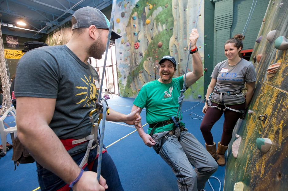 Instructors James Przybylski left and Jess Levine work with Dan Basset of Meriden Saturday during an adaptive rock climbing day by Gaylord Hospital Sports Association at Prime Climb in Wallingford Mar. 25, 2017 | Justin Weekes / For the Record-Journal
