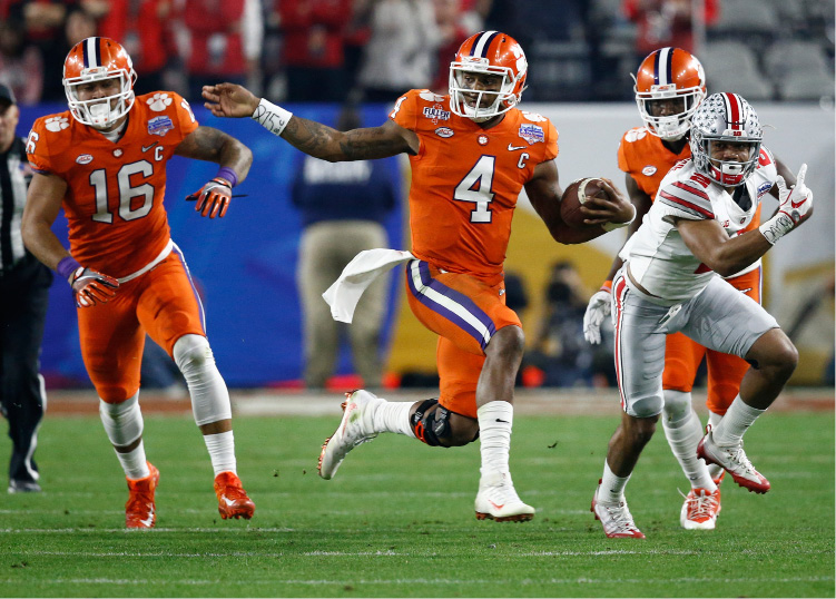 Clemson quarterback Deshaun Watson (4) runs as Ohio State cornerback Marshon Lattimore (2) pursues during the first half of the Fiesta Bowl NCAA college football playoff semifinal, Saturday, Dec. 31, 2016, in Glendale, Ariz. (AP Photo/Ross D. Franklin)