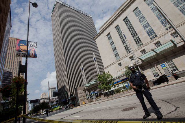 Police patrol outside Fifth Third Bank building on Fountain Square after a shooting with multiple fatalities on Thursday, Sept. 6, 2018, in downtown Cincinnati. (Albert Cesare/The Cincinnati Enquirer via AP)