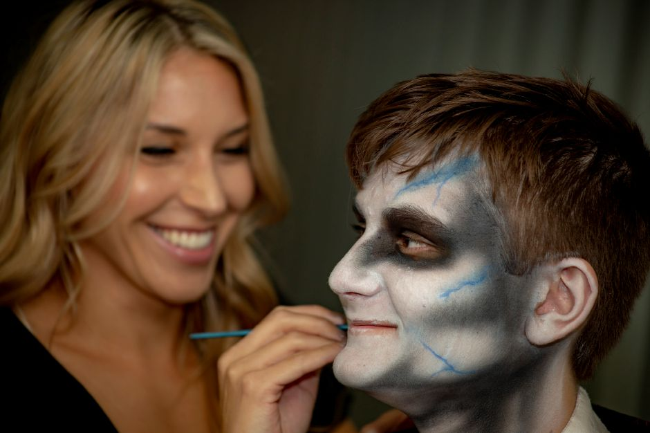 Makeup artist Christina Klanchich turns Ethan Hall into a vampire at the Haunted Graveyard in Lake Compounce Sept. 27, 2018. | Richie Rathsack, Record-Journal