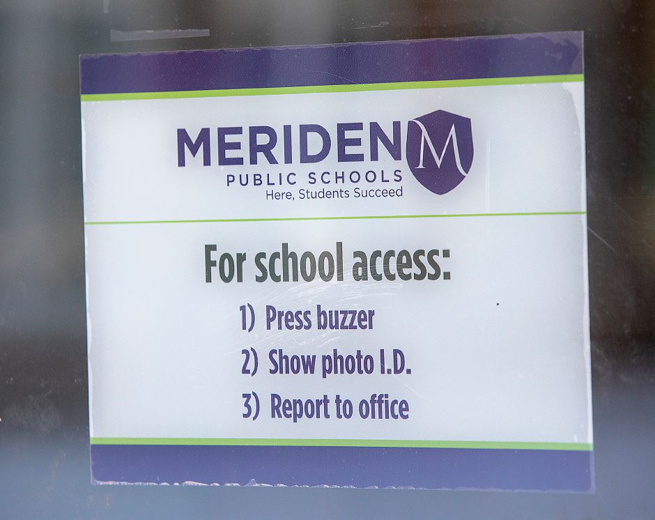 A school access sign on the front door of John Barry Elementary School in Meriden, Mon., Mar. 11, 2019. Dave Zajac, Record-Journal