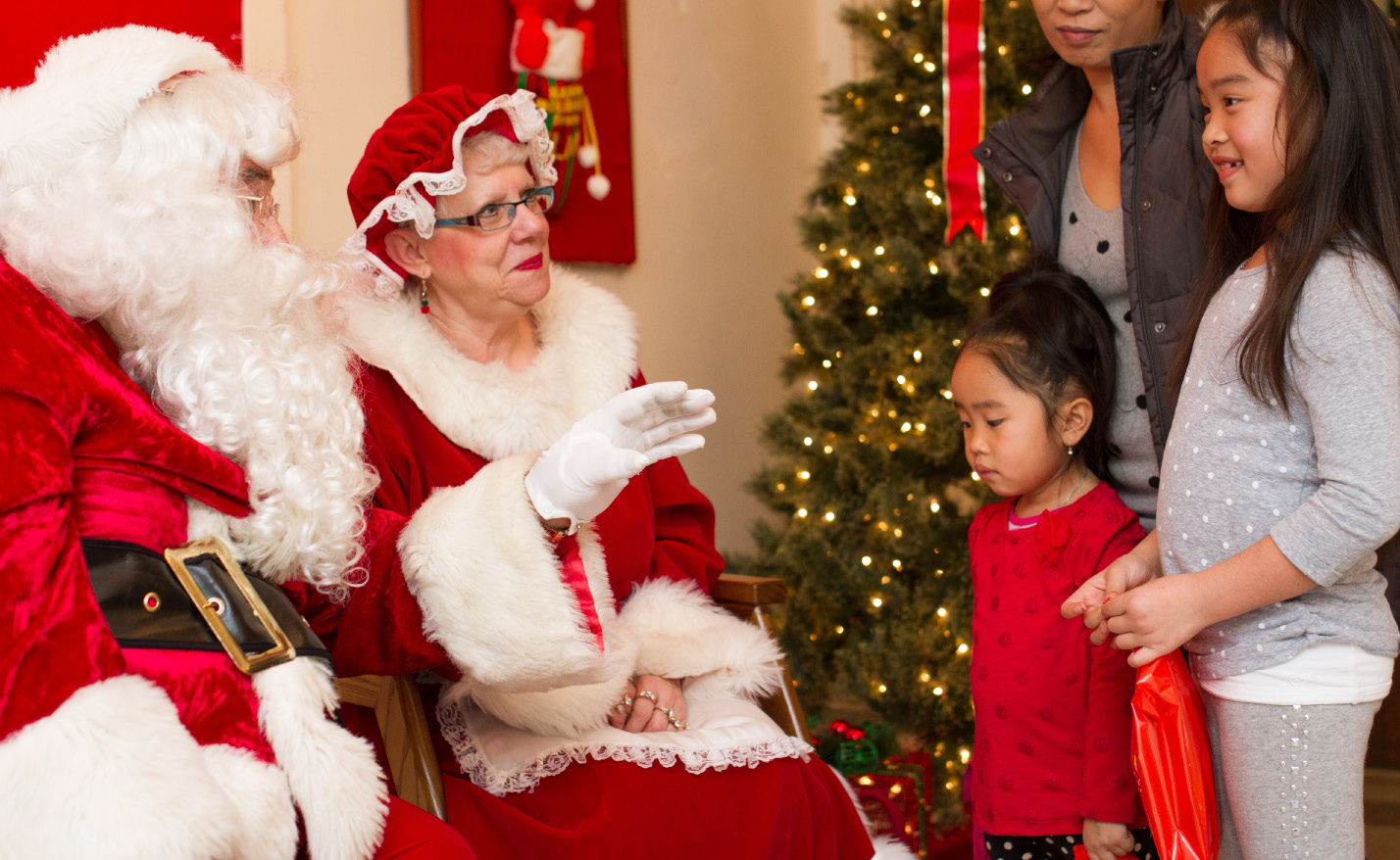 Santa Claus and Mrs. Claus talk to kids during the 2014 Seasons of Celebration in Wallingford. | File photo, Record-Journal
