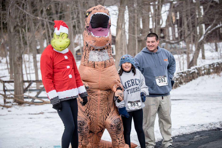 Runners at previous Go Far Jingle All the Way 5Ks. This year