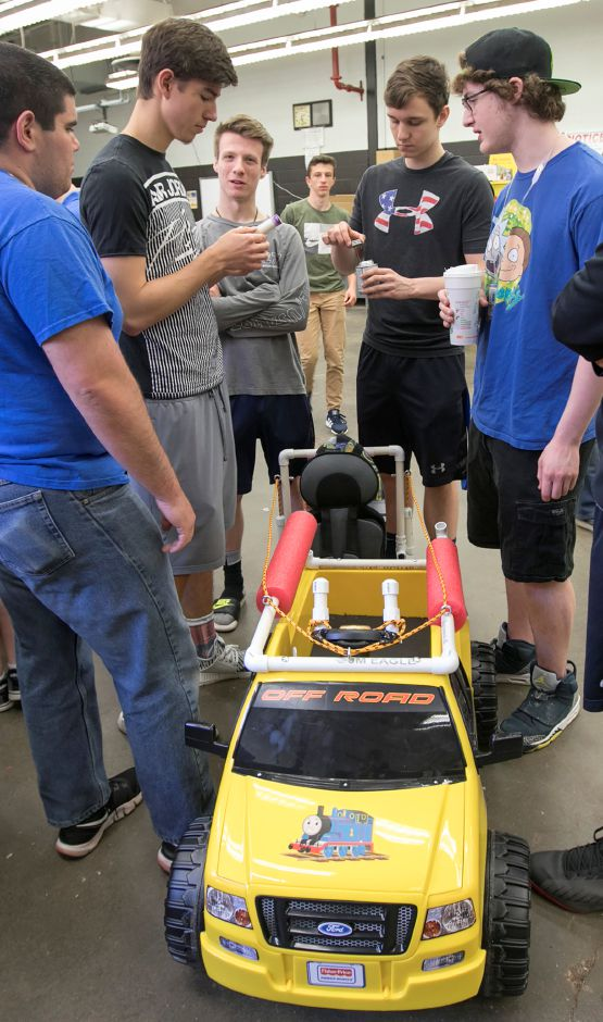 Students from Southington High School and Central Connecticut State University make the final fittings to battery-powered cars. Photos by Dave Zajac, Record-Journal
