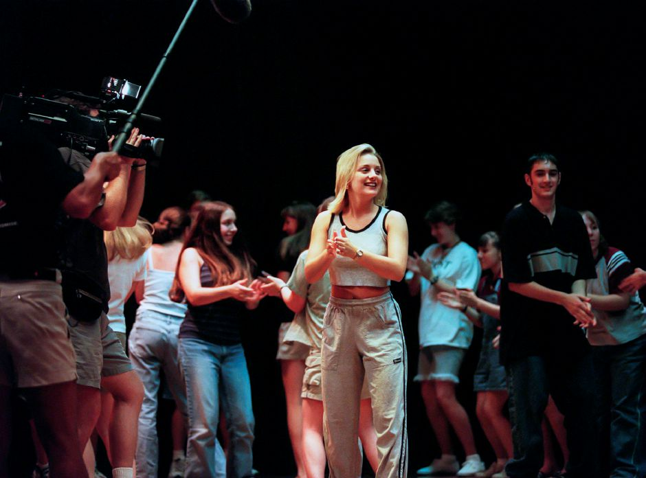 RJ file photo - Lauren Bergamo works on a dance number with a summer theater group at Derynoski School in Southington July 1998, while a camera crew records the moment. She will compete in Miss Connecticut in the Miss America Pageant in September.