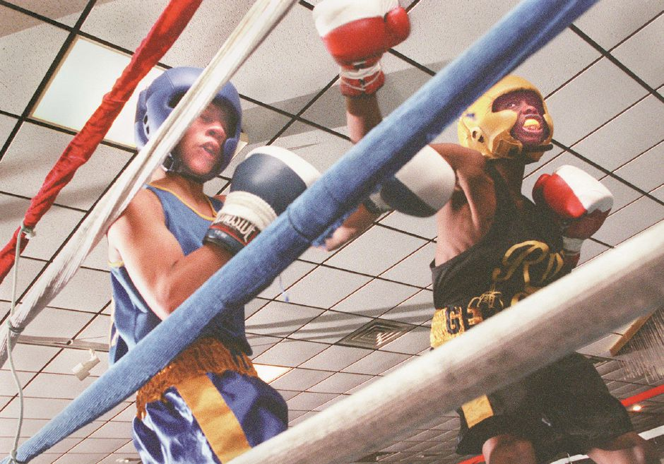 RJ file photo - Germaine Dawson, right, of Ring One in New Haven knocks DeJesus Ortiz into the ropes on his way to a dominating victory at Zandri
