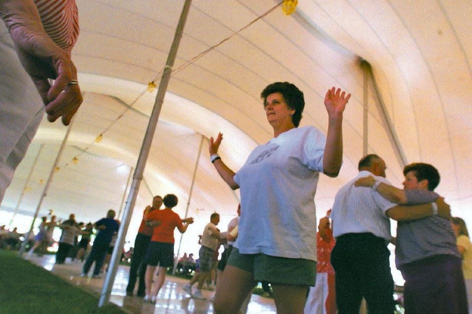 RJ file photo - Lorraine Hourigan of Meriden gets into the polka rhythm with other dancers at Polka Fest