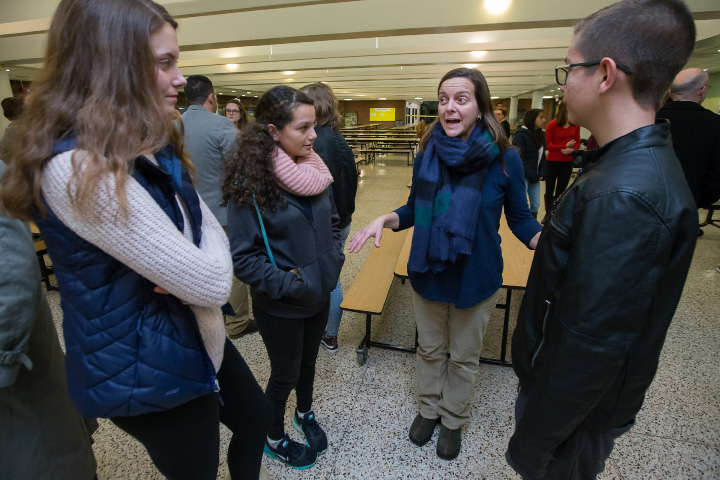 Mia Sullivan, 15, left, and her mother, Audra, center right, talk over plans to travel to Vermont with Costa Rican exchange students Daniela Castillo, 14, center left, and Jorge Escalante, 14, during a welcome dinner at Southington High School.| Photos by Justin Weekes, Special to the Record-Journal