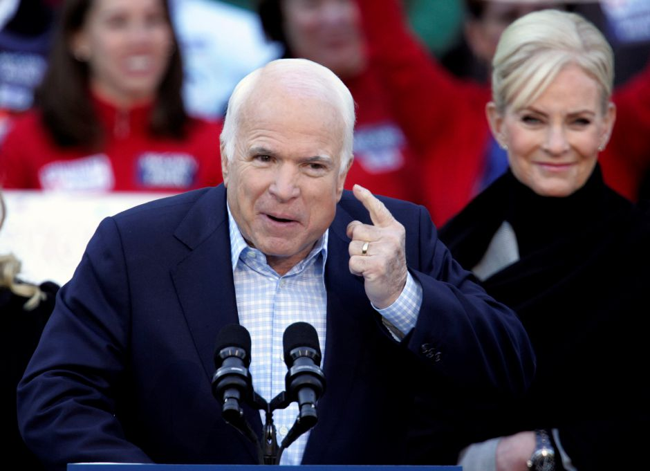 Republican presidential candidate Sen. John McCain, R-Ariz., speaks at a rally at the Christopher Newport University in Newport News, Va., Saturday, Nov. 1, 2008. His wife, Cindy, is at right. (AP Photo/Steve Helber)