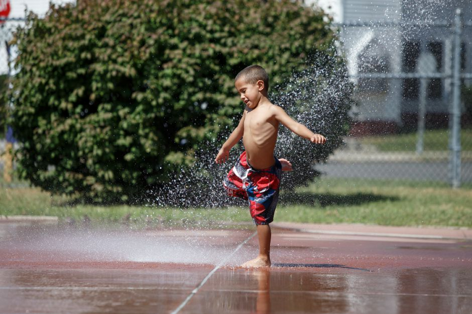 Lein Figueroa 4 of Meriden tests the water Monday at the Meriden City Water Park in Meriden September 3, 2018 | Justin Weekes / Special to the Record-Journal