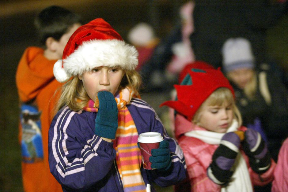 "SOUTHINGTON, Connecticut - Thursday, December 6, 2007 - Sisters Emily Sargent 9, left, and Christine Sargent 5, of Milldale, eat donuts on Thursday, Dec. 6 during the annual ""Christmas in the Village"" event. Rob Beecher / Record-Journal"