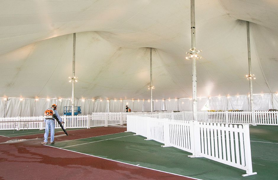Parks and Recreation workers clean up under a tent in preparation for the annual Daffodil Festival at Hubbard Park in Meriden, Tues., Apr. 23, 2019. Dave Zajac, Record-Journal