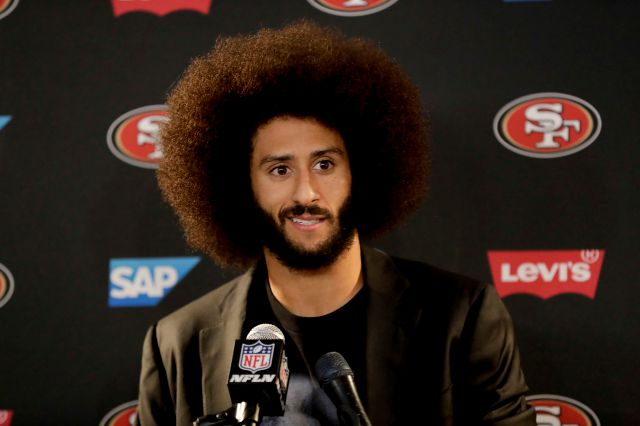 FILE - In this Dec. 24, 2016, file photo San Francisco 49ers quarterback Colin Kaepernick talks during a news conference after an NFL football game against the Los Angeles Rams. The free agent quarterback was named GQ magazine