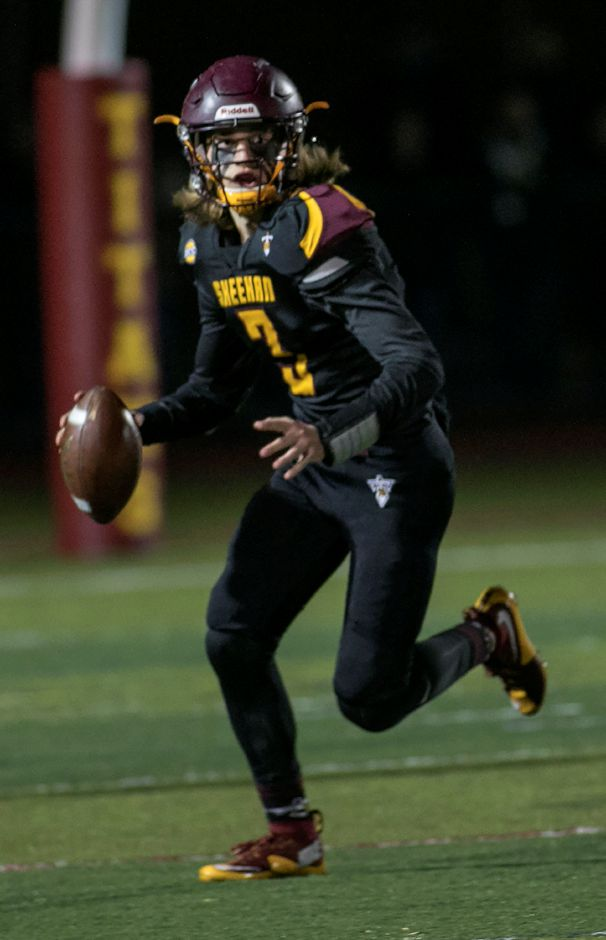 Sheehan quarterback Weston Terzi looks for a receiver during the second half of the Class M quarterfinals at Sheehan High School, Tuesday, Nov. 28, 2017. | Dave Zajac, Record-Journal