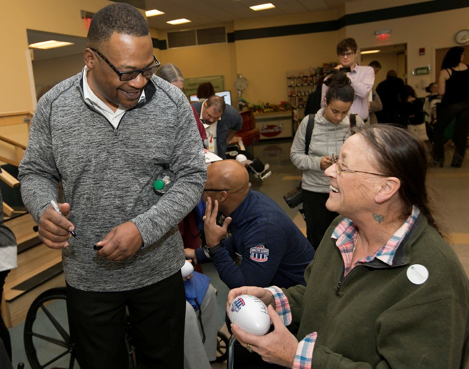 Blair Thomas, a Penn State 1989 WCFF All-American, left, shares smiles with patient Beth Margaret Roche, of New Britain, during Walter Camp day at Gaylord Specialty Healthcare in Wallingford, Friday, Jan. 12, 2018. Thomas also played for the New York Jets, New England Patriots and Dallas Cowboys. Dave Zajac, Record-Journal