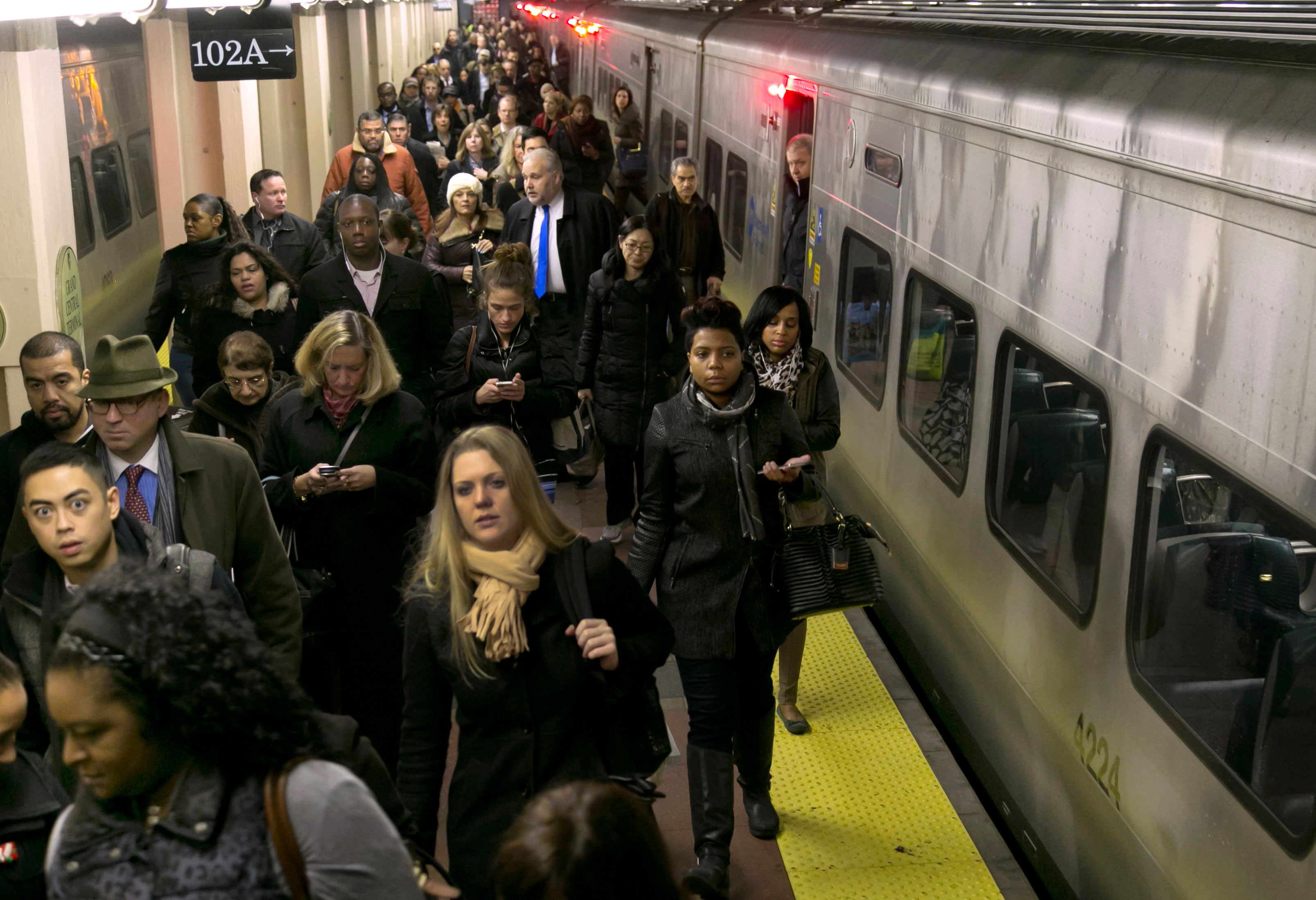 Passengers exit a Hudson Line Metro-North train at New York