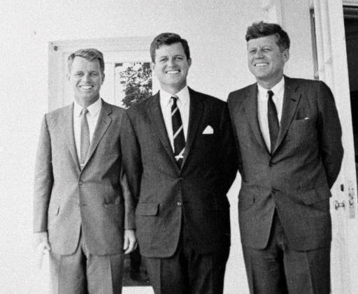 Sen. Edward M. Kennedy, center, poses with his brothers U. S. Attorney General Robert F. Kennedy, left, and President John F. Kennedy at the White House in Washington in this August 23,1963 photo. (AP Photo)
