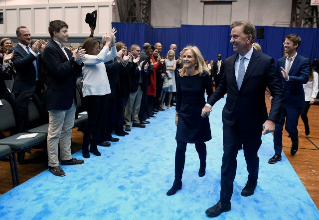 Connecticut Gov. Ned Lamont and wife Annie depart his inaugural ceremonies, Wednesday, Jan. 9, 2019, inside the William A. O