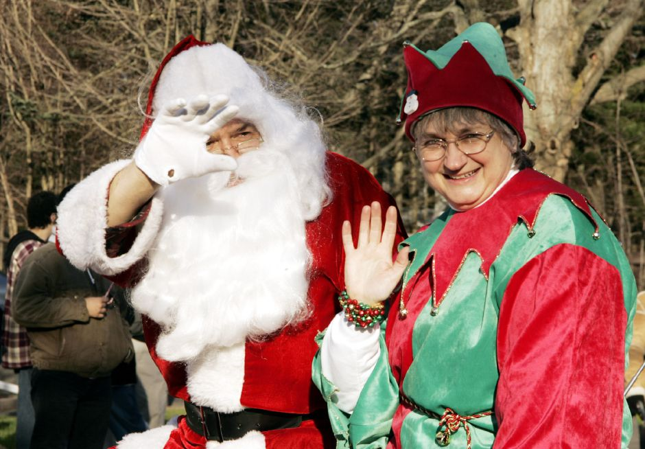 Santa and the head elf wave from their car in the Christmas in the Village parade Sat. afternoon, Dec. 2 in South Meriden.
