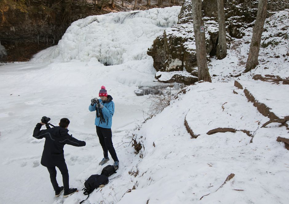 Drew Marino, left, and Jacob Bojnowski, of Middletown, set up their camera gear for photos at frozen Wadsworth Falls in Middlefield, Tuesday, Jan. 2, 2018. Dave Zajac, Record-Journal