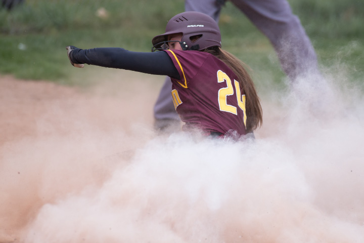 Sheehan's Samantha Iannone slides into home to put the Titans up 1-0 against Lyman Hall Wednesday at Lyman Hall High School in Wallingford. | Justin Weekes, Special to the Record-Journal