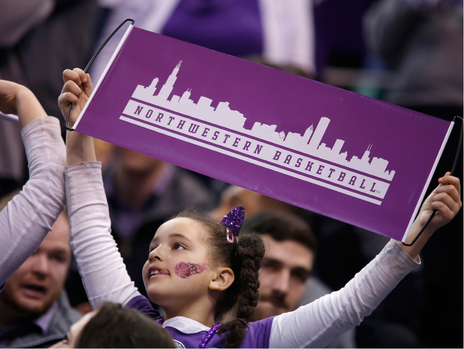 A Northwestern fans holds a sign during the first half of a first-round men