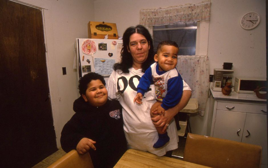 RJ file photo - Karen Askew, a mother of three, holds her grandson 14-month-old Henry Rhodes. Her son Kyle Doucette, 6, is at left. January 1994.