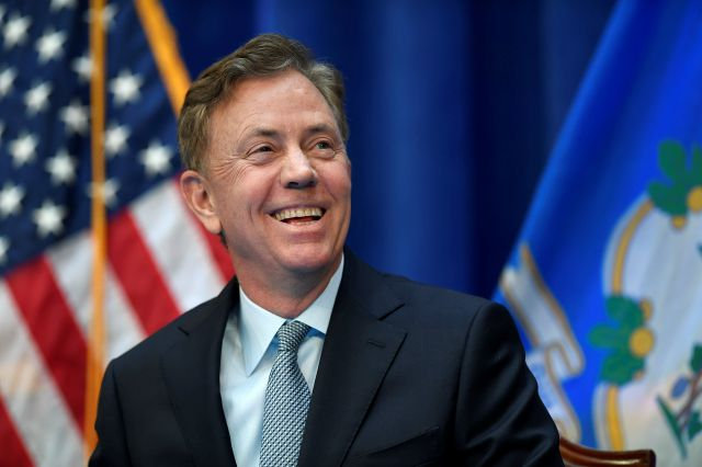 Connecticut Gov. Ned Lamont smiles during his inauguration, Wednesday, Jan. 9, 2019, inside the William A. O
