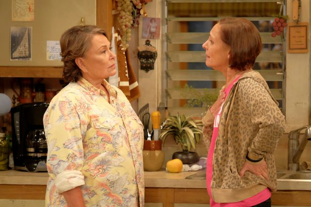 "In this image released by ABC, Roseanne Barr, left, and Laurie Metcalf appear in a scene from the reboot of the popular comedy series ""Roseanne."" ABC, which canceled its ""Roseanne"" revival over its star"
