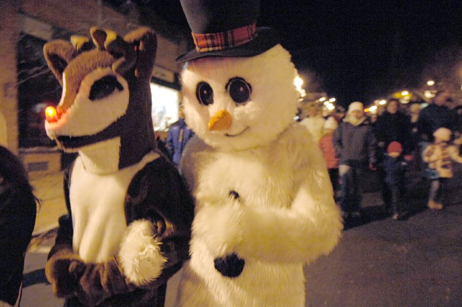 WALLINGFORD, Connecticut - Saturday, December 1, 2007 - Rudolph the red-nosed reindeer and Frosty the snowman lead a group of townspeople down Center Street during Wallingfords Seasons of Celebration event on Saturday, Dec 1. Frosty and Rudolph the red-nosed reindeer lead a parade that began at town hall to Fishbein Park before carols were sung and the Christmas tree was lit. Rob Beecher / Record-Journal