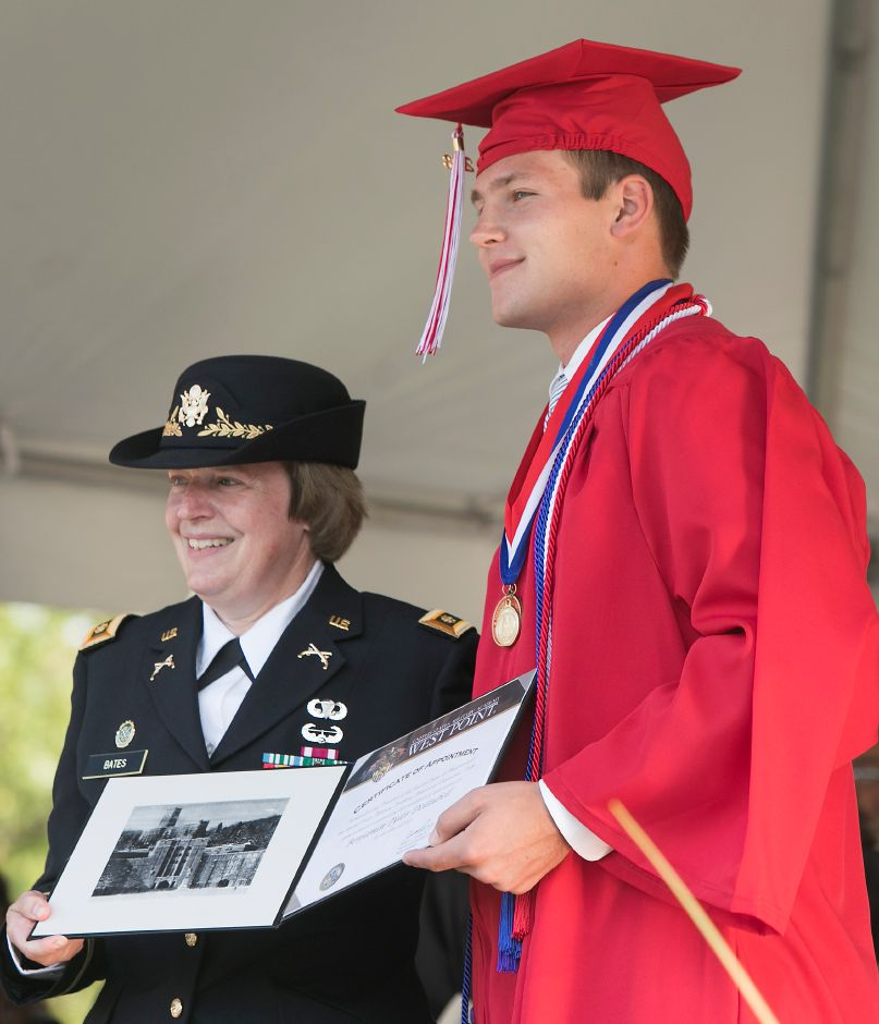 Graduate Benjamin DeLaubell receives a United States Military Academy West Point Certificate of Appointment by Retired Army Maj. Nancy Bates during graduation ceremonies at Cheshire High School, Thursday, June 21, 2018. DeLaubell is one of 22 people in Connecticut to be appointed to West Point this year. Dave Zajac, Record-Journal