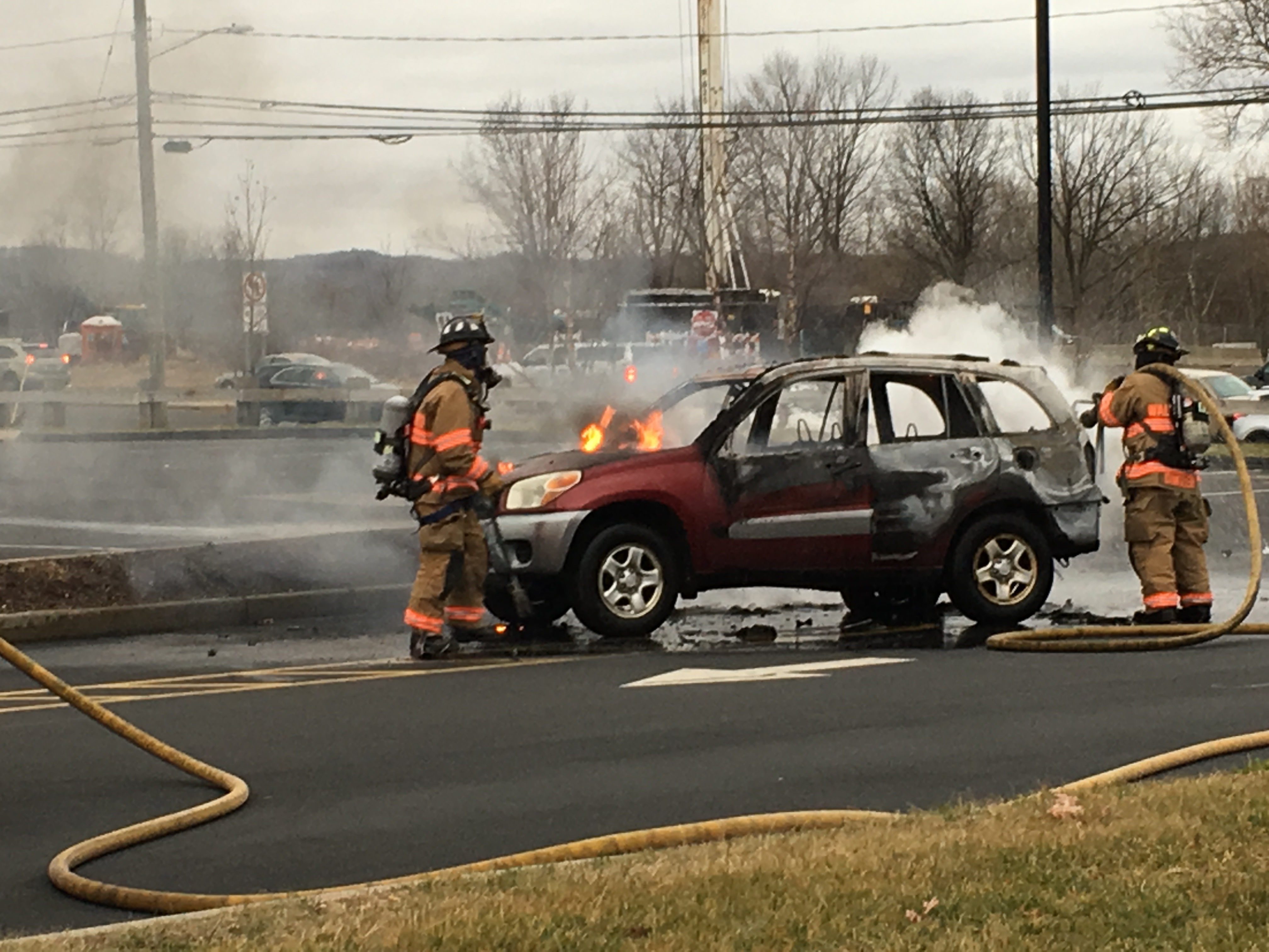 Firefighters extinguished a vehicle fire in the parking lot of IHOP on Route 5 just before 3:30 p.m. on Monday, Jan. 23, 2017. No injuries were reported. | Lauren Takores, Record-Journal