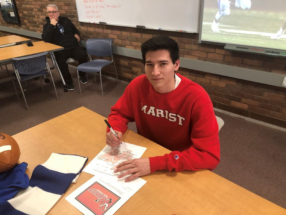 Southington senior Will Downes signs his National Letter of Intent to play at Division I Marist in the fall.