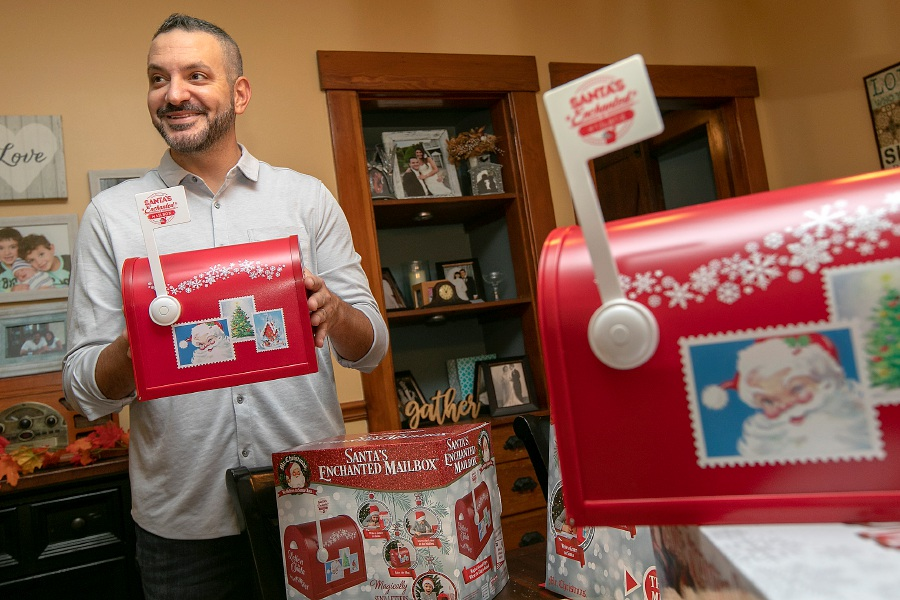 "Chris Cirri, of Wallingford, talks about his ""Santa's Enchanted Mailbox"" on Thursday. Letters to Santa ""magically"" disappear to the North Pole. Letters can also reappear in the mailbox. The product is now available on Amazon and at WalMart, Home Depot, Lowes and many other stores. It is also available in select shops in Australia and QVC in the United Kingdom. Photos by Dave Zajac, Record-Journal"