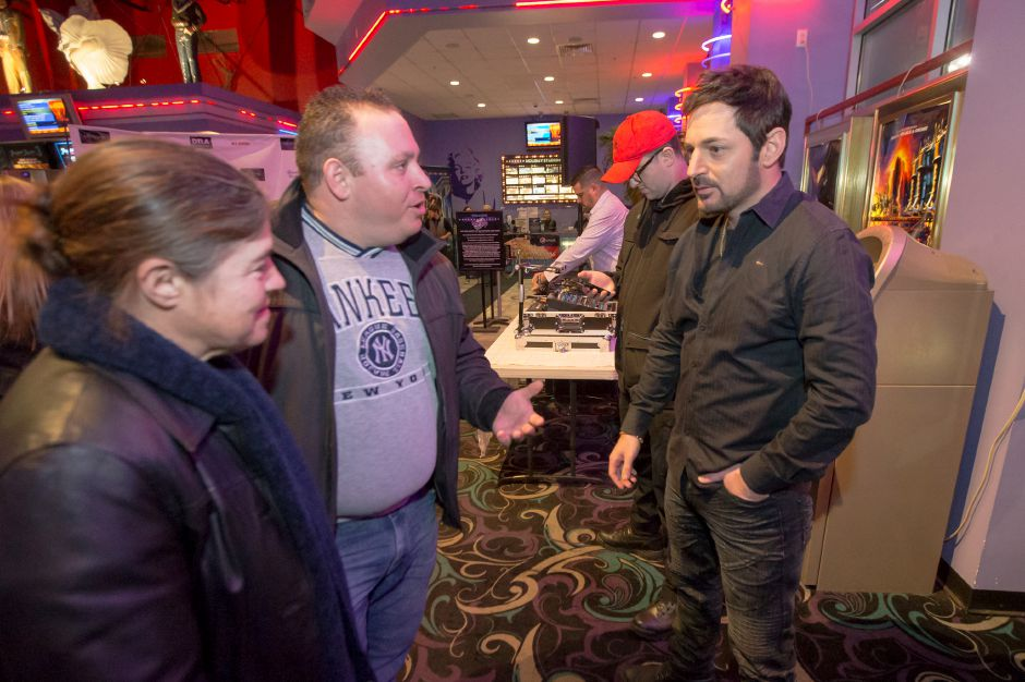 "Producer David Gere, right, talks with Angelo J. Marino and Agostina Marino, both of Wallingford,  at Thursday's premiere of ""Blood Circus"" at Holiday Cinemas in Wallingford.  Photos by Justin Weekes, special to the Record-Journal"