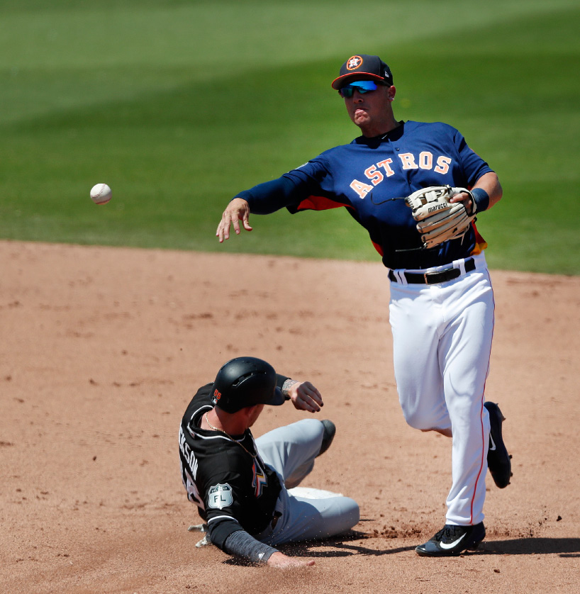 Houston Astros shortstop Alex Bregman (2) avoids Miami Marlins