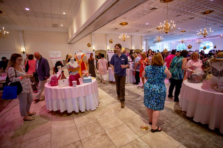 Attendees at the Art Bra 2018 browse through the raffle items at the Aqua Turf Aug. 9, 2018. Richie Rathsack, Record-Journal