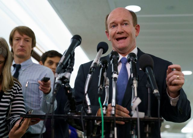 Senate Judiciary Committee member Sen. Chris Coons, D-Del., talks to media after a Senate Judiciary Committee hearing on Capitol Hill in Washington, Friday, Sept. 28, 2018. After a flurry of last-minute negotiations, the Senate Judiciary Committee advanced Brett Kavanaugh