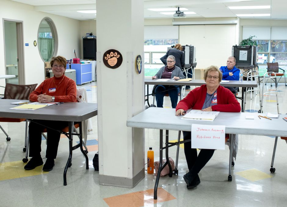 Poll workers at Toffolon Elementary School in wait for voters during a lull in activity during the Nov. 5, 2019 Plainville municipal elections. | Devin Leith-Yessian/Plainville Citizen