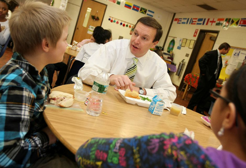 Congressman Chris Murphy eats lunch with Gary Swarz, 10 (left), and other 5th graders at Roger Sherman Elementary School in Meriden on Tuesday December 14, 2010. Murphy had lunch with the students a day after President Obama signed the new student nutrition law. (Matt Andrew/ Record-Journal)