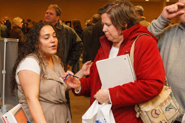 Cierra Rivera of East Hartford talks about respite programs with Carol Lehman of Meriden during the post-high school transition expo Wednesday at the Four Points by Sheraton in Meriden. | Photos by Justin Weekes / For the Record-Journal