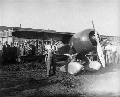 Maj. Jimmie Doolittle, former champion speed pilot of the army, was in Chicago, superintending the completion of a mystery plane, he will fly in the national air races at Cleveland, August 22, 1931. The ship according to E.M. Laird, the designer and builder will make 300 miles an hour. (AP Photo)