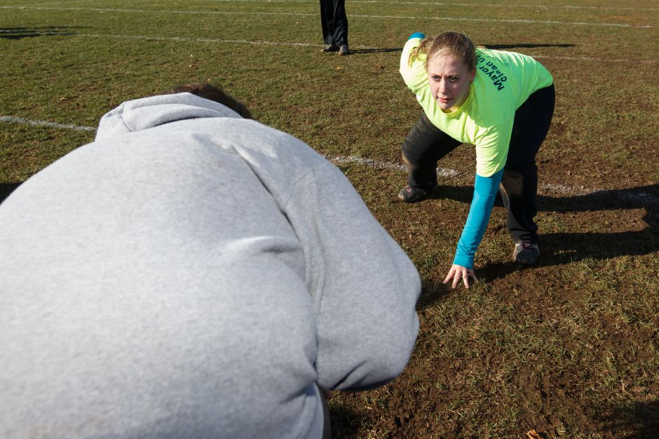 Rachel Betts 16 right lines up with Ashley Greenier 17 during a blocking drill Saturday during Powder Puff practice at Wilcox Tech in Meriden Nov 15, 2014 | Justin Weekes / For the Record-Journal