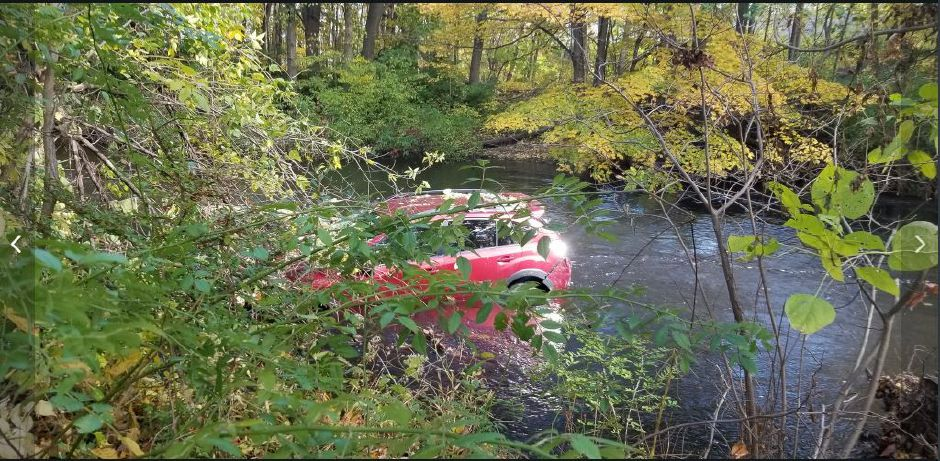 A vehicle went down an embankment and into the Quinnipiac River Friday. No injuries were reported.| Jeniece Roman, Record-Journal staff