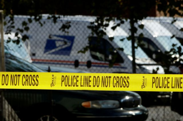 Police tape cordons off a post office in Wilmington, Del., Thursday, Oct. 25, 2018.  A law enforcement official said suspicious packages addressed to former Vice President Joe Biden  were intercepted at Delaware mail facilities in New Castle and Wilmington and were similar to crude pipe bombs sent to former President Barack Obama, Hillary Clinton and CNN. (AP Photo/Matt Rourke)