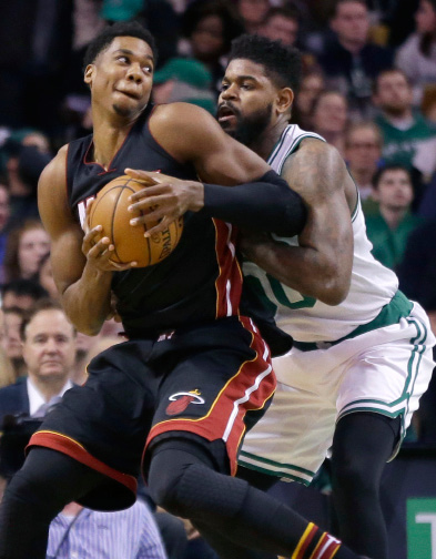 Miami Heat center Hassan Whiteside, left, makes a move against Boston Celtics forward Amir Johnson, right, in the first quarter of an NBA basketball game, Friday, Dec. 30, 2016, in Boston. (AP Photo/Elise Amendola)