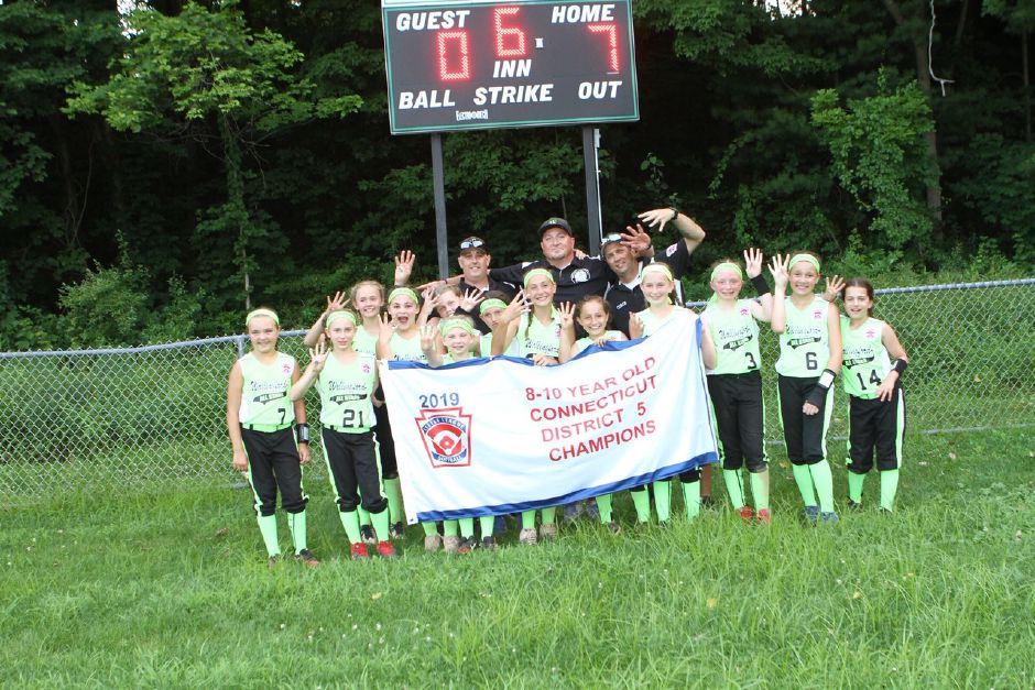 The Girls Little League Softball of Wallingford 10U team celebrate its District 5 on Wednesday in Wallingford.