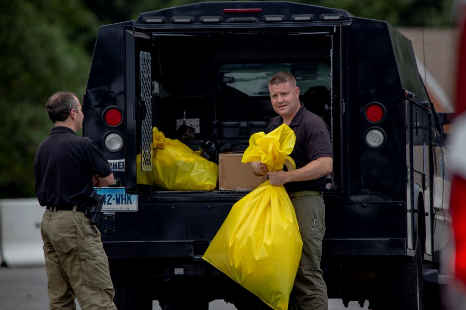 Members of the Connecticut State Police Bomb Squad tape up a bag after investigating a suspicious powder in the mail room of the Money Source in Meriden Sept. 21, 2018. | Richie Rathsack, Record-Journal