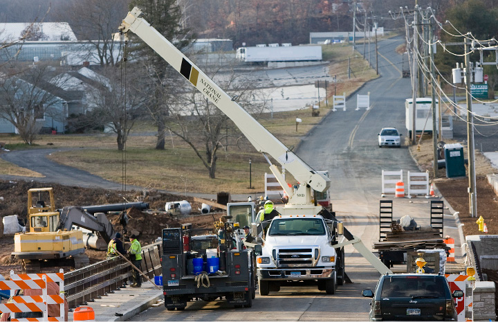 Work continues on the the East Johnson Avenue bridge in Cheshire on Wednesday. The bridge, closed since June, is expected to be open to traffic late next week.| Dave Zajac, Record-Journal